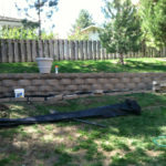 Finished retaining wall and landscaping back yard