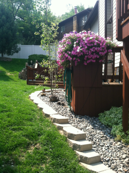 Small retaining walls create depth and contrast in your landscaping.