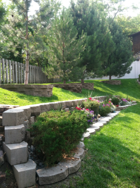 Two layers of retaining wall form a planter in between.