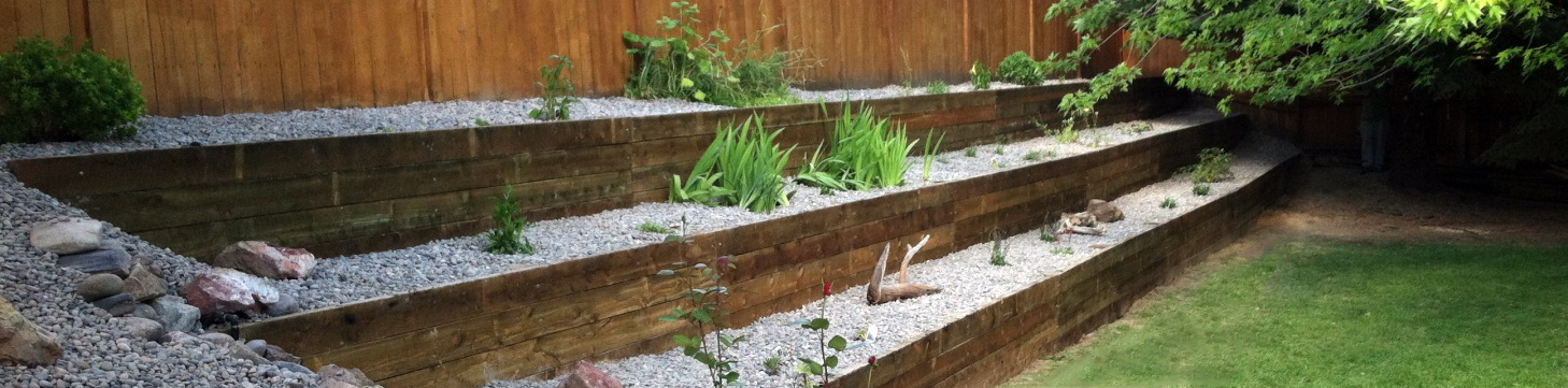 We've worked on a number of unique landscaping projects, including this retaining wall with railroad ties.