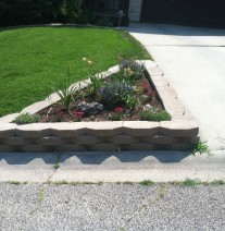 Custom flower bed next to driveway