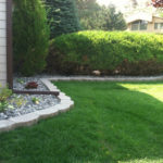 landscaped lawn with rock bed
