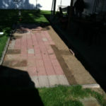 red brick patio with lawn