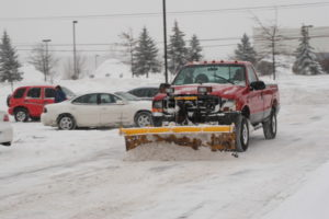 snow plow on front of truck